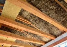 Exposed insulation and wooden beams on the roof