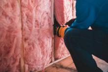 Professionals working on insulating walls