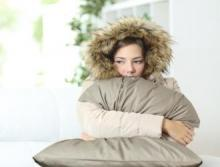 Girl in coat with pillow